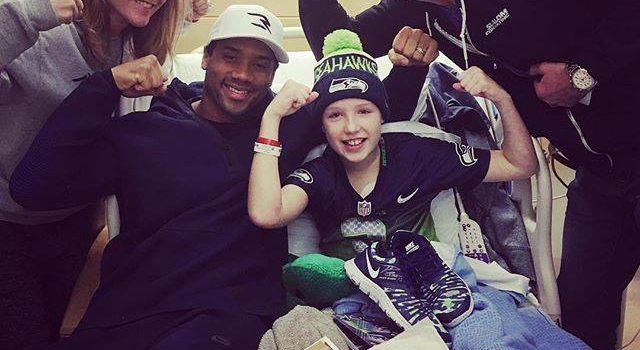 In a photo posted on his Facebook page, Russell Wilson said he wanted to give a pair of shoes to young fan Avery, a patient at Seattle Children's Hospital, because she is Strong Against Cancer.